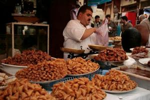 Vendor Selling Ramadan Sweets in Morocco (Used by permission of Sarah Kramer.)