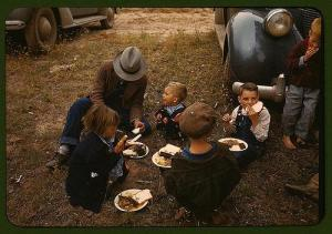 Homesteader Eating with his Family, 1940 (Library of Congress)