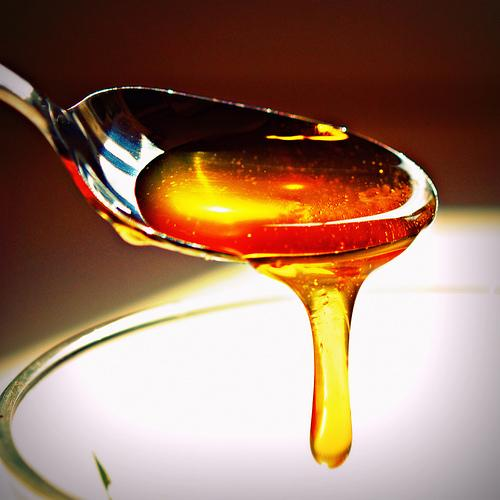 Bees honey on a spoon