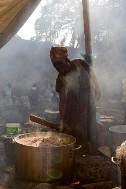 Displaced by Quake, Haiti Woman Cooks in Camp